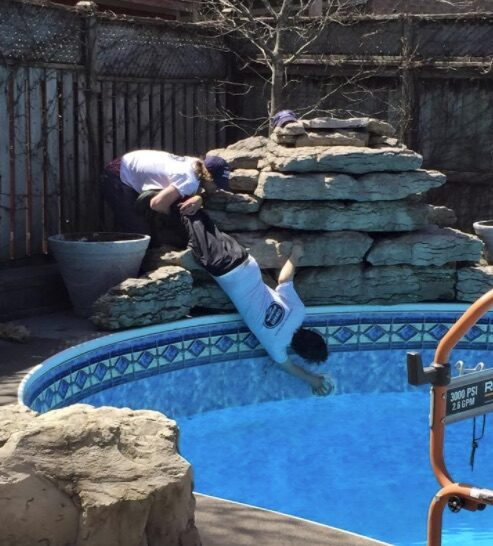 pool professionals opening a swimming pool for the season